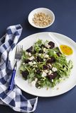 Beetroot and feta salad with pinenuts and orange dressing. A Plate of roasted Beetroot and feta salad with pinenuts and orange dressing royalty free stock photos