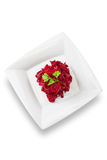 Beetroot, grated, on white square plate Stock Images
