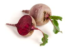 Beetroot and half with leaf isolated on white background Royalty Free Stock Photography