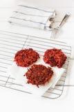 Beetroot hash browns on grid, vegan Stock Images