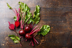 Beetroot with herbage green leaves. Red Beetroot with herbage green leaves on wooden background Royalty Free Stock Photo
