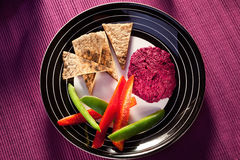 Beetroot humus with whole wheat pita bread Stock Image