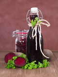 Beetroot juice and inlaid beetroot Royalty Free Stock Images