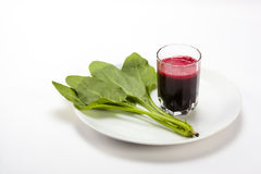 Beetroot juice with spinach Stock Image