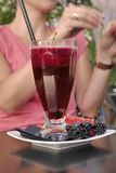Beetroot juice with a straw in the restaurant Stock Images