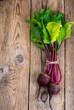 Beetroot on old wooden table Stock Images