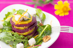Beetroot and orange salad. With goat cheese and walnuts Stock Images