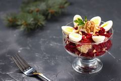 Beetroot and potato salad with quail eggs on a dark background stock images