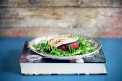 Beetroot an quinoa patty, vegetarian burger with mozzarella on arugula Royalty Free Stock Images