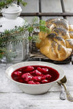 Beetroot red borsch with polish dumplings uszka Stock Photos