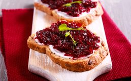 Beetroot relish over brown bread Stock Photography