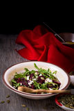 Beetroot salad with arugula, feta cheese and pumpkin seeds Stock Images