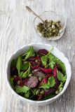 Beetroot salad with baked red onion, capers, watercress and greens. Beetroot salad with baked red onion, capers, watercress, greens and vinaigrette sauce. Vegan Royalty Free Stock Photography