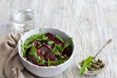 Beetroot salad with baked red onion, capers, watercress and greens. Beetroot salad with baked red onion, capers, watercress, greens and vinaigrette sauce. Vegan Stock Photos