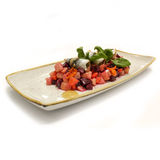Beetroot salad on blue plate. Stock Photos