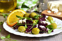 Beetroot salad with brynza,olives and rucola. Royalty Free Stock Photo