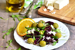 Beetroot salad with brynza,olives and rucola. Royalty Free Stock Images
