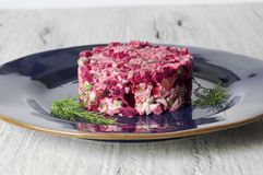 Beetroot salad with chicken, green peas, carrots, onions and yoghurt dressing stock photo