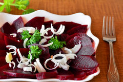 Beetroot salad with chopped onion on the white plate Royalty Free Stock Image