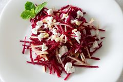 Beetroot salad with feta cheese, pears and nuts dressing sunflower oil. White background. Top view. Close up. Copy space stock image