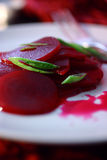 Beetroot salad with fresh chopped leek. On plate Stock Photo