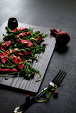 Beetroot salad, with goat cheese, hazelnut and rocket leaves. Stock Photography
