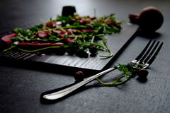 Beetroot salad, with goat cheese, hazelnut and rocket leaves. Royalty Free Stock Photography