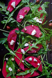 Beetroot salad, with goat cheese, hazelnut and rocket leaves Royalty Free Stock Photo