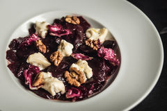 Beetroot salad with goat cheese and walnuts. Vegetarian food. Restaurant Stock Photos