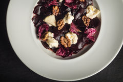 Beetroot salad with goat cheese and walnuts. Vegetarian food. Restaurant Royalty Free Stock Photo