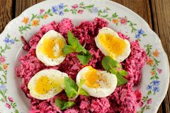Beetroot salad with mint and boiled eggs Royalty Free Stock Images