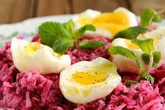 Beetroot salad with mint and boiled eggs Royalty Free Stock Photos