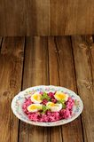 Beetroot salad with mint and boiled eggs Royalty Free Stock Image
