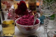 Beetroot salad on a table background of wine glasses and juice. Beetroot salad on a table on a background of wine glasses and juice 2017 stock photo