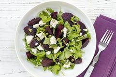 Beetroot Salad Top View. Beetroot salad, top view, on grunge white timber.  Arugula, feta cheese, and pepitas Royalty Free Stock Images