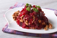 Beetroot salad with walnuts close-up horizontal Royalty Free Stock Photography