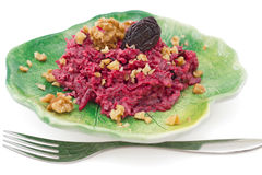 Beetroot salad with walnuts on green plate Stock Image