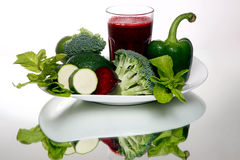 Beetroot smoothie in glass, near fresh broccoli, green pepper, avocado Royalty Free Stock Photo