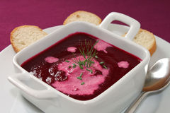 Beetroot Soup. A bowl of organic beetroot soup served with bread Stock Images