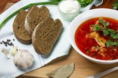 Beetroot soup, borscht. Ukrainian, russian beetroot soup borscht on napkin on wooden background Royalty Free Stock Photos