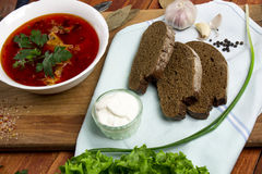 Beetroot soup, borscht. Ukrainian on russian beetroot soup borscht on napkin on wooden background Stock Photos