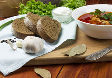 Beetroot soup, borscht. Ukrainian on russian beetroot soup borscht on napkin on wooden background Royalty Free Stock Photos