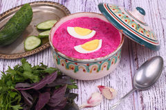 Beetroot soup - cold soup with a beet and egg submitted with greens Royalty Free Stock Photo