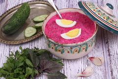 Beetroot soup - cold soup with a beet and egg submitted with greens Royalty Free Stock Images