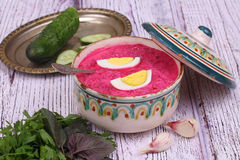 Beetroot soup - cold soup with a beet and egg submitted with greens Stock Photography