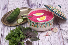 Beetroot soup - cold soup with a beet and egg submitted with greens Stock Images