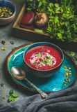 Beetroot soup with mint, chia, flax and pumpkin seeds Royalty Free Stock Photography