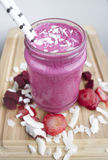 Beetroot, Strawberry and Coconut smoothie. Stock Photo