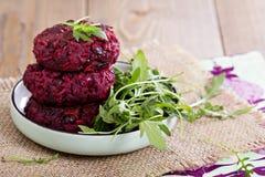 Beetroot vegan burgers with rice and beans Stock Photos