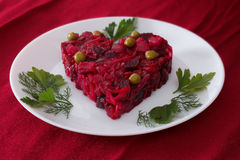 Beetroot and vegetables salad made in hearth shape served with herbs on plate Royalty Free Stock Images